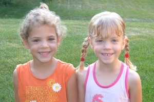 Cassie and Callie start afternoon kindergarten (this isn't there first day picture but it is cute).  They are playing fall soccer too!
